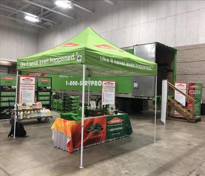SERVPRO tent in front of a SERVPRO semi trailer with SERVPRO equipment at a municipalities conference