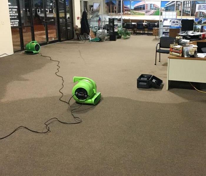 Water damage in Business and SERVPRO equipment set for mitigation