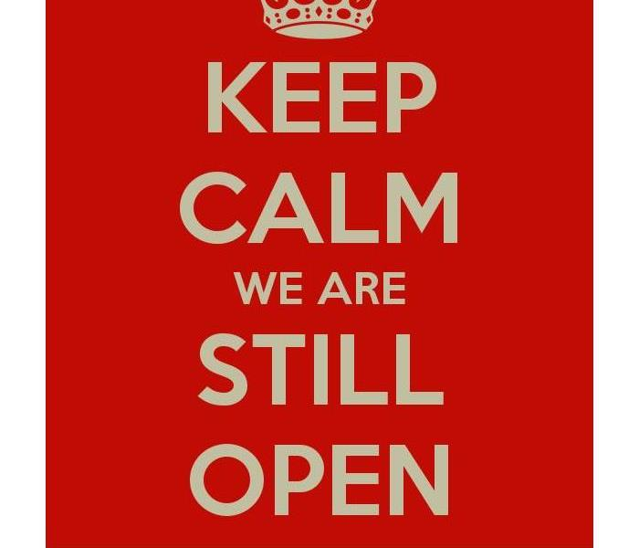 "sign that says ""keep calm we are still open"""